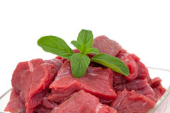 Pieces of fresh beef in a glass bowl Royalty Free Stock Photography