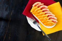 Pieces of fresh citrus fruits (grapefruit, mandarin, orange) Stock Image