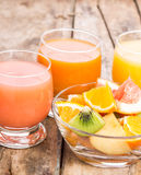 Pieces of fresh fruits in glass bowl with juice Stock Photography