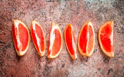 Pieces of fresh grapefruit royalty free stock photography