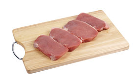 Pieces of fresh meat on cutting board Stock Images