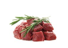 Pieces of fresh raw meat with rosemary. On white background Stock Image