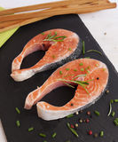 Pieces of fresh salmon. On chopping board Royalty Free Stock Photography