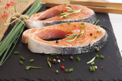 Pieces of fresh salmon. On chopping board Royalty Free Stock Photo