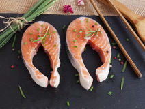 Pieces of fresh salmon. On chopping board Stock Images