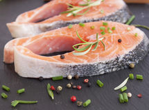 Pieces of fresh salmon. On chopping board Stock Image