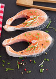 Pieces of fresh salmon. On chopping board Royalty Free Stock Image