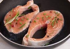 Pieces of fresh salmon on the pan.Fresh salmon Stock Photos