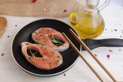 Pieces of fresh salmon on the pan. Salmon fresh. Royalty Free Stock Photography