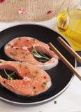Pieces of fresh salmon on the pan. Salmon fresh. Stock Photos