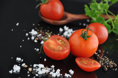 Pieces of Fresh Tomato with Spice Royalty Free Stock Photos