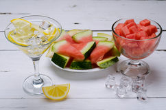 Pieces of fresh watermelon and lemon drink on a wooden table. Royalty Free Stock Image