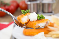Pieces of fried Fish on a fork Stock Photos