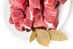 Pieces of frozen meat with laurel leaves isolated Royalty Free Stock Images