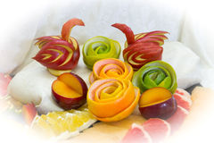 Pieces of fruit, swans from fruit Royalty Free Stock Image