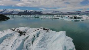 Pieces of glaciers in the ocean bay near Iceland stock video footage