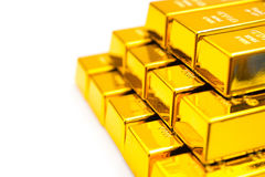 Pieces of gold bars stacked up on white Royalty Free Stock Images