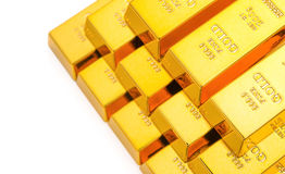 Pieces of gold bars stacked up on white background. Pieces of gold bars stacked up on a white background royalty free stock photo