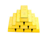 Pieces of gold bars stacked up on white background Royalty Free Stock Photography