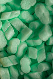 Pieces of green styrofoam in carton box background Stock Image