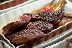 Pieces of grilled duck meat in a dish Stock Photos