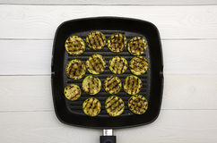 Pieces of grilled squash in the pan on a white background top vi Stock Image
