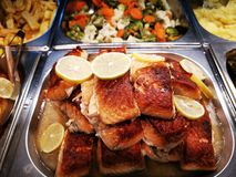 Pieces of grilled wild salmon. With lemon slices and vegetable dishes stock photo