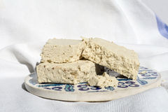 Pieces of halva on the traditional ceramic plate Stock Images