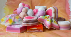 Pieces of hand-made soap. Still life made of pieces of hand-made soap with watercolor background Stock Photo