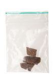 Pieces of hashish in a plastic bag Royalty Free Stock Image