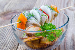 Pieces of Herring on a Stick Stock Photo
