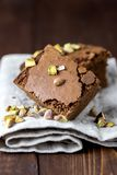 Pieces of Homemade Chocolate Brownies With Nuts Lying on Linen Napkin Vertical Horizontal.  royalty free stock photo