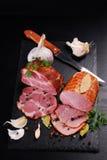Pieces of homemade smoked pork ham on black background Royalty Free Stock Image
