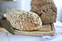 Pieces of homemade wholemeal bread. Over wooden table with clean table napkin Royalty Free Stock Photos