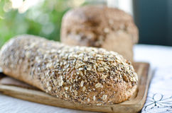 Pieces of homemade wholemeal bread. Over wooden table with clean table napkin Stock Photo