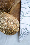Pieces of homemade wholemeal bread. Over wooden table with clean table napkin Stock Image