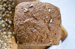 Pieces of homemade wholemeal bread. Over wooden table with clean table napkin Stock Images