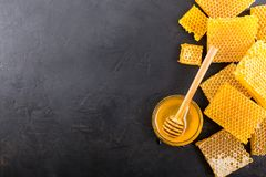 Pieces honeycomb with honey. On a dark wooden background.Top view. Copy space Stock Photography