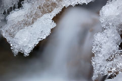 Pieces of ice on the creek. The first frost formed an intricate icicles on a mountain stream royalty free stock photo