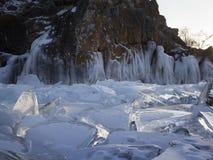 Pieces of ice glisten in the sun. Lake Baikal, Russia. Stock Photos