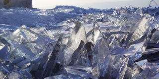 Pieces of ice glisten in the sun. Lake Baikal, Russia. Royalty Free Stock Photos
