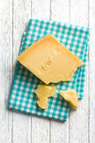 Pieces of Italian hard cheese on a wooden table Royalty Free Stock Image