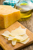 Pieces of Italian hard cheese on a wooden table Royalty Free Stock Images