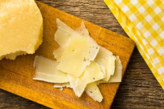 Pieces of Italian hard cheese on a wooden table Stock Photo