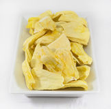 Pieces of jackfruit in white plate. On white background royalty free stock image