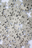 Pieces of Jigsaw Puzzle Background Stock Photo