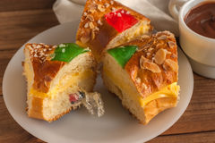 Pieces of Kings cake Roscon de Reyes with surprise Stock Images