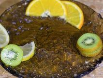Pieces of kiwi orange and lemon in water stock photos