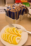 Pieces of lemon and sugar bags. Royalty Free Stock Photo