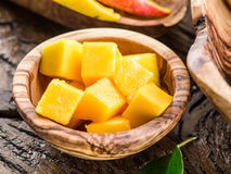 Pieces of mango fruit in a wooden bowl. Royalty Free Stock Photo